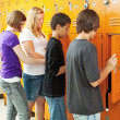 Stock Photo: Teens at Lockers
