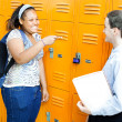 School Friends Laughing by Lockers - Stock Photo