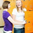 Teenage Girls Gossip by Lockers — Stock Photo
