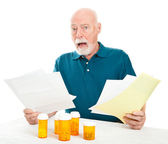 Senior Overwhelmed by Medical Costs — Stock Photo