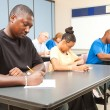 Stock Photo: Adult Students Taking Test