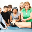 Stock Photo: Teacher with CPR Class and Dummy
