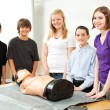 Teenagers with CPR Training Mannequin — Stock Photo