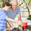 Stock Photo: Family Project - Oil Change