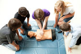 Teenagers Practice CPR — Stock Photo