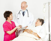 Discussing Patient Progress — Stock Photo