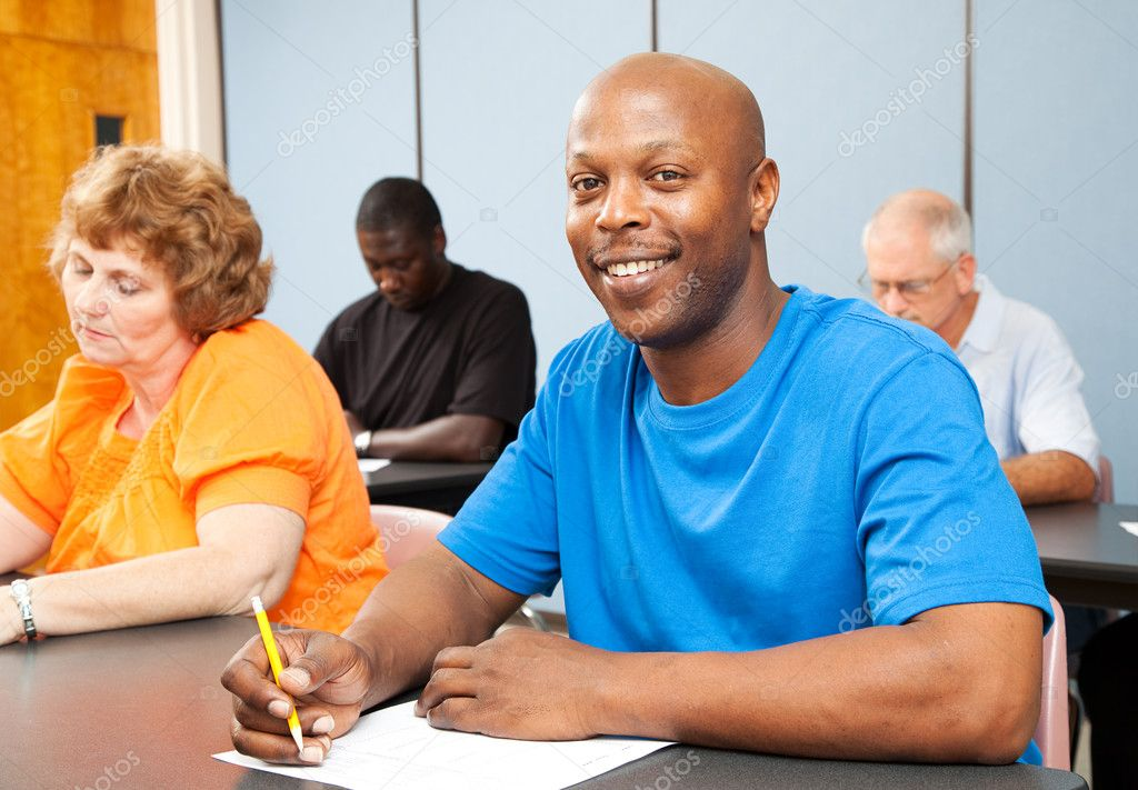 Portrait of a handsome African-american college student in adult education class.   — Stock Photo #7314804