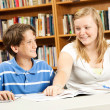 Disabled Boy with Teen Tutor — Stock Photo