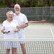 Stock Photo: Active Seniors on Tennis Court