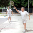 Retirees Playing Racquetball — Stock Photo