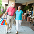 Royalty-Free Stock Photo: Shopping Seniors - Carrying Her Bags