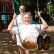 Senior Woman Reliving Childhood — Stock Photo