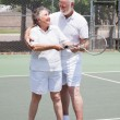 Stock Photo: Tennis Lesson - Senior Woman