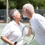 Tennis Seniors Kiss — Stock Photo #7322170