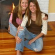 Beautiful Sisters By Fireplace — Stock Photo