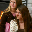 Pretty Sisters by Fireplace — Stock Photo #7322245