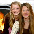 Royalty-Free Stock Photo: Sisters By The Fireside