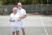 Active Seniors on Tennis Court — Stock Photo