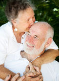 Senior Couple - Kiss for Husband — Stock Photo