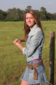 Country Girl by Fence 1 — Stock Photo