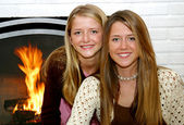 Sisters By The Fireside — Stock Photo