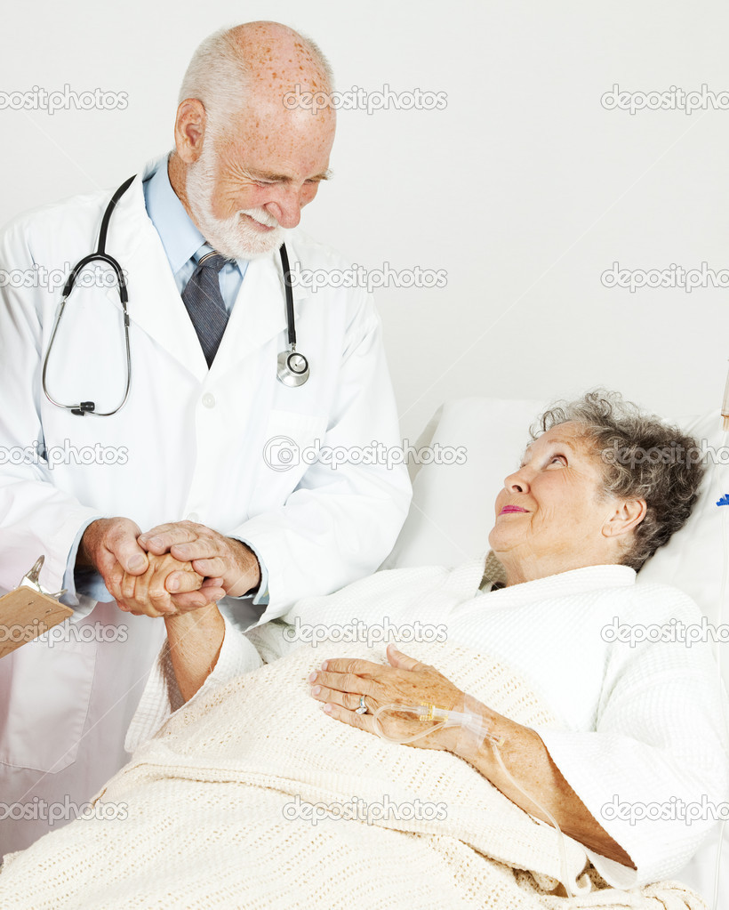 Friendly doctor comforting a senior hospital patient.   — Stock Photo #7322059