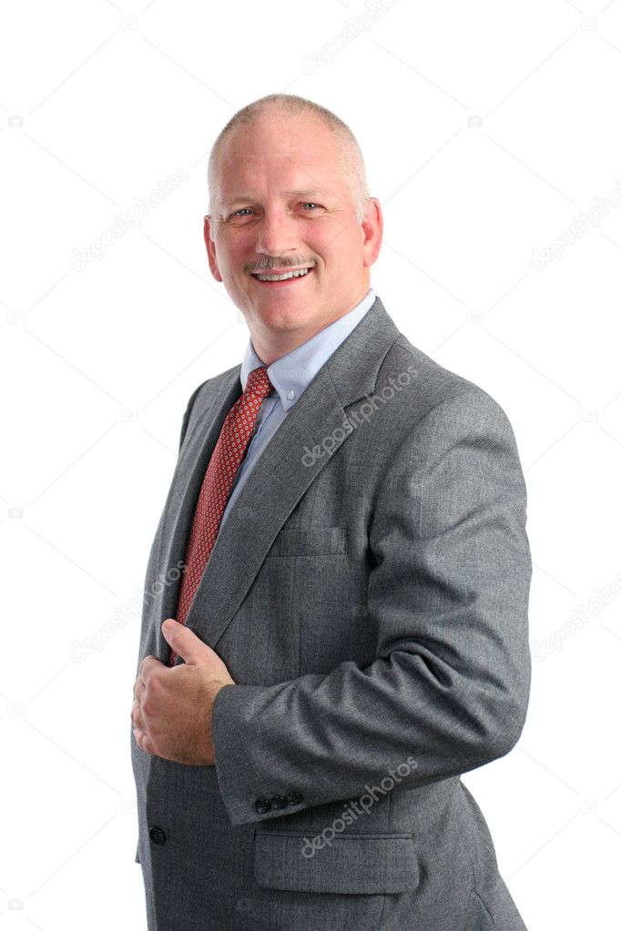 A handsome businessman smiling, in a formal pose — Stock Photo #7323095