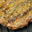 Hamburger on a grill - Stock Photo