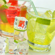 Fruit cocktails with ice cubes — Stock Photo