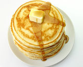 Pancakes with butter and maple syrup. — Stock Photo