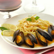 Mussels with spaghetti - Stock Photo