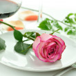 Stock Photo: Romantic dinner with rose on plate