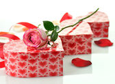 Holiday gifts with rose — Stock Photo