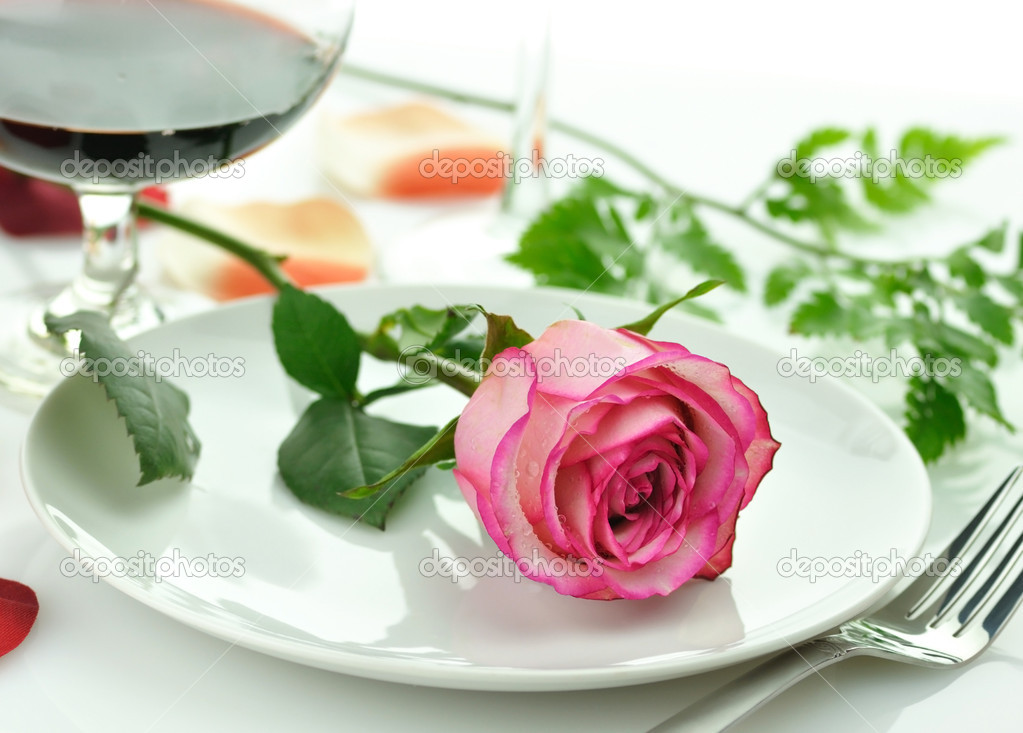  romantic dinner with rose on a plate   Stock Photo #6779113