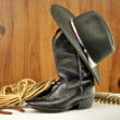 Black cowboy hat and boots — Stock fotografie