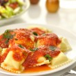 Stock Photo: Ravioli pasta with red tomato sauce