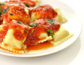 Ravioli pasta with red tomato sauce — Stock Photo