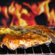 Stock Photo: Pork ribs on grill