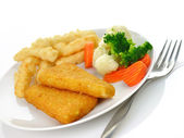 Fish fillets with fried potato and vegetables — Stock Photo