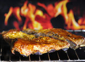 Pork ribs on a grill — Stock Photo