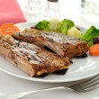 Stock Photo: Pork ribs with barbecue sauce