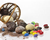 Chocolate eggs and candies — Stock Photo