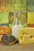 Milk bottle , cheese and fresh rolls — Stock Photo