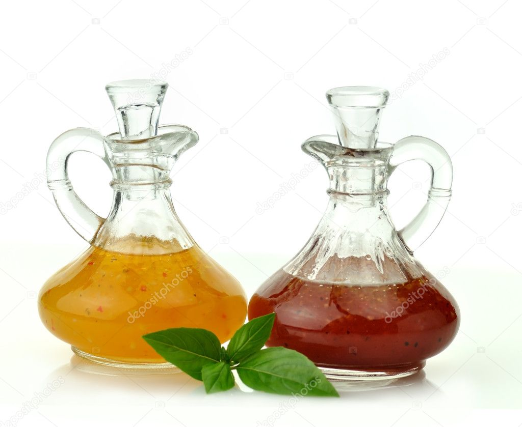 Italian and raspberry vinaigrette salad dressings in glass bottles  — Stock Photo #6822295