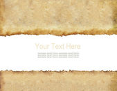 Old grunge paper with scratch space and sample text — Stockfoto