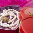 Pearls in a heart-shaped box on a pink background — Stock Photo #7382057