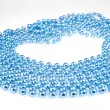 Shining blue beads on white — Stock Photo
