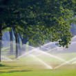 Golf course gets irrigated — Stock Photo