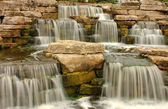 Beautiful waterfall in the park — Stock Photo