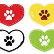 Stock Vector: Paw Print Icons